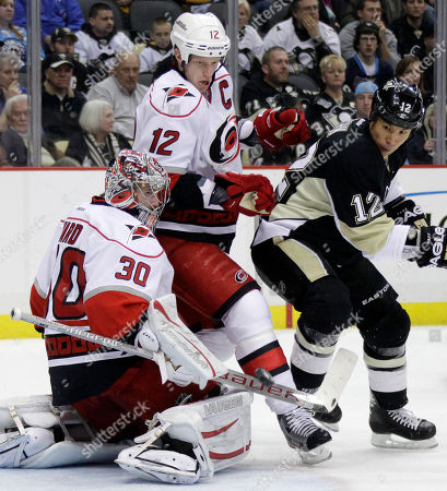 Cam Ward, Richard Park, Eric Staal Carolina Hurricanes goalie Cam Ward (30) blocks a shot as Pittsburgh Penguins' Richard Park (12) battles Hurricanes' Eric Staal (12) for the rebound in the second period of an NHL hockey game in Pittsburgh