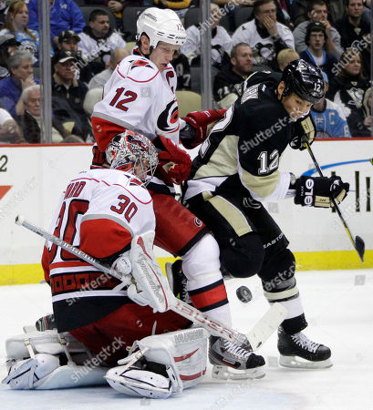 Cam Ward, Richard Park, Eric Staal Carolina Hurricanes goalie Cam Ward (30) blocks a shot as Pittsburgh Penguins' Richard Park (12) battles Hurricanes' Eric Staal (12) for the rebound in the second period of an NHL hockey game in Pittsburgh on