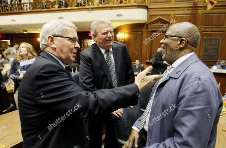 Rep. Bill Friend, left, R-Macy, and Eric Turner, R-Cicero, talk with Rep. Charlie Brown, D-Gary, following a session at the Statehouse, in Indianapolis