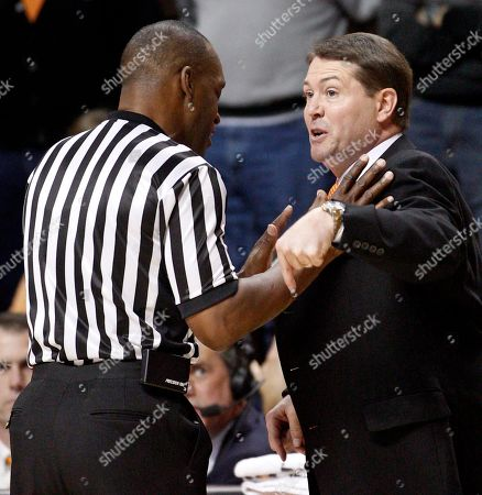 Travis Ford, Terry Moore Oklahoma State head coach Travis Ford, right, argues with official Terry Moore, left, in the first half of an NCAA college basketball game against Kansas State in Stillwater, Okla., . Kansas State won 66-58