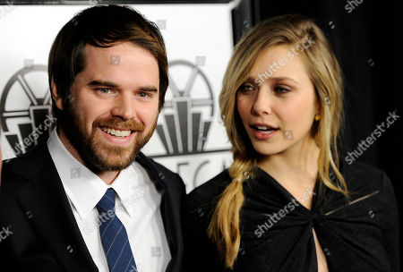 """Sean Durkin, Elizabeth Olsen Sean Durkin, left, writer/director of the film """"Martha Marcy May Marlene,"""" and cast member Elizabeth Olsen, two of the winners of the """"New Generation"""" award, pose together at the 37th Annual Los Angeles Film Critics Association Awards, in Los Angeles"""