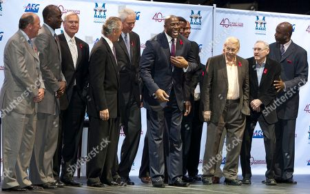 """Stock Picture of Michael Cooper, Mike Dunleavy, Jerry West, Pat Riley, Mitch Kupchak, Earvin Magic Johnson, AC Green, Gary Vitti, Mychal Thompson, Jerry Buss, James Worthy, Bill Sharman Los Angeles Lakers' team members, from left: Michael Cooper, Mike Dunleavy, Jerry West, Pat Riley, Mitch Kupchak, Earvin """"Magic"""" Johnson, A.C. Green, Gary Vitti, Mychal Thompson, Dr. Jerry Buss, James Worthy and Bill Sharman pose for a photo with Johnson, sixth from left, during a ceremony of the Magic Johnson Foundation in Los Angeles on Monday, Non. 7, 2011"""