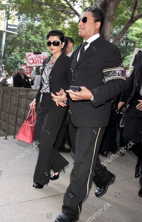 Michael Jackson's brother Jermaine Jackson and his wife Halima Rashid arrive at the courthouse after it was announced that jurors had reached a verdict in the involuntary manslaughter trial of Dr. Conrad Murray, Michael Jackson's physician when the pop star died in 2009, at the the Criminal Justice Center in downtown Los Angeles