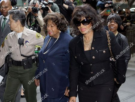 Michael Jackson's mother Katherine Jackson, left, and sister Rebbie arrive for the sentencing of Conrad Murray, convicted of involuntary manslaughter in the death of pop star Michael Jackson, at the Los Angeles Criminal Justice Center