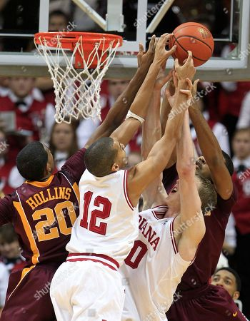 Verdell Jones III, Cody Zeller, Austin Hollins, Ralph Sampson III Minnesota's Austin Hollins (20) and Ralph Sampson III, right, vie with Indiana's Verdell Jones III (12) and Cody Zeller for a rebound during the second half of an NCAA college basketball game, in Bloomington, Ind. Minnesota defeated Indiana 77-74