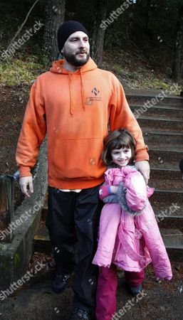 Stewart Schmidt walks with 6-year-old daughter, Aidan Schmidt after being found by rescuers, in Mount Hood National Forest, near Estacada Ore. The Clackamas County sheriff's office says the father, son and daughter were seen from the air on Tuesday afternoon. Search crews then met them, confirmed they were in good condition and took them to reunite with other family members. The three were found near Timothy Lake in Mount Hood National Forest. They were reported missing Monday night
