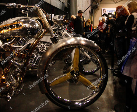 Paul Teutul Jr., center, star of Discovery Channel's Senior Vs. Junior American Chopper, introduces the 911 Tribute Bike at the Progressive International Motorcycle Show on in New York. The custom-made motorcycle commemorates the rebuilding of the World Trade Center, and commissioned by 9/11 Memorial Board Member Daniel Tishman