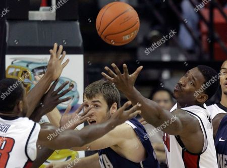 Stock Picture of Quintrell Thomas, Olek Czyz UNLV's Quintrell Thomas, right, and Nevada's Olek Czyz, center, battle for a rebound in the first half of an NCAA college basketball game, in Las Vegas