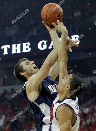 Stock Photo of Olek Czyz, Chace Stanback Nevada's Olek Czyz, left, shoots against UNLV's Chace Stanback in the first half of an NCAA college basketball game, in Las Vegas