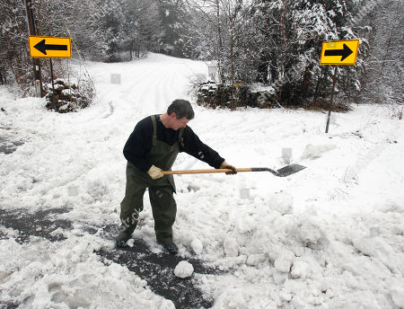 Stock Photo of Ed Devereaux Ed Devereaux shovels snow in front of his driveway after a storm in Greenville, N.Y., on . The storm dumped up to 8 inches in the southern Adirondacks while parts of the Mohawk and Hudson Valleys have received 4 to 6 inches, forcing scores of schools to cancel classes or delay their start by two hours