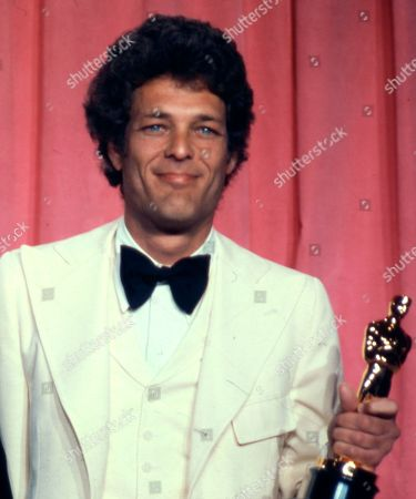 """Bert Schneider Movie producer Bert Schneider holds the Oscar he received with co-producer Peter Davis for Best Documentary feature, """"Hearts and Minds,"""" at the 47th annual Academy Awards at the L.A. Music Center. """"Five Easy Pieces"""" producer Bert Schneider, credited for inspiring a """"New Hollywood"""" band of independent filmmakers, died in Los Angeles, his daughter Audrey Simon tells the Los Angeles Times. He was 78"""