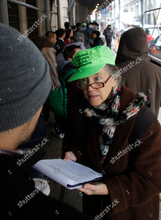 Judith Anderson, left, a lawyer working as an observer for the National Lawyers Guild, records information of protesters from the Occupy Wall Street movement as they stand on a line outside Manhattan Criminal Court on in New York. Protesters are answering summons stemming from their mass arrest during a march across the Brooklyn Bridge last October