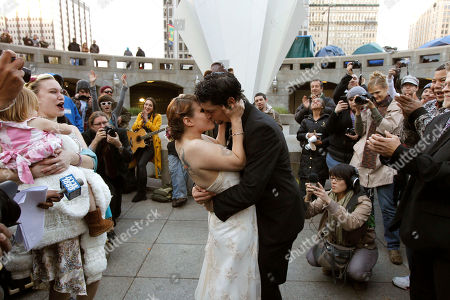 """Alicia """"Ally"""" Nauss, Adam Hill Alicia """"Ally"""" Nauss, left, and Adam Hill kiss at the end of their wedding ceremony at the Occupy Philadelphia encampment in front of City Hall in Philadelphia. Nauss and Hill met while working the information tent at Occupy Philadelphia. The encampment at City Hall is one of many being held across the country similar to the ongoing Occupy Wall Street demonstration in New York"""