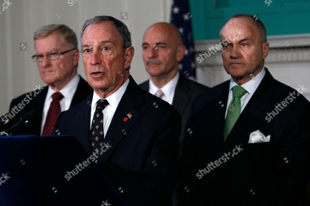 Stock Picture of New York City Mayor Michael Bloomberg, second from left, stands with Sanitation Commissioner John J. Doherty, left, Fire Commissioner Salvatore J. Cassano, second from right, and Police Commissioner Raymond Kelly during a press conference at City Hall about the events at the Occupy Wall Street Encampment at Zuccotti Park in New York