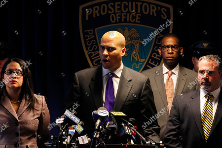 Cory Booker, Samuel Anthony DeMaio, Jeffery Jones, Camelia M. Valdes As Passaic County prosecutor Camelia M. Valdes, left, Newark police director Samuel Anthony DeMaio, right, and Paterson Mayor Jeffery Jones, second right, listen, Newark Mayor Cory Booker, at podium, answers a question after it was announced in Paterson, N.J., that there have been arrests in the slaying of Michael Morgan, an off-duty Newark police detective who was gunned down this week during a robbery outside a northern New Jersey strip club where he was celebrating a friend's birthday. Jerome Wright, 24, who had multiple addresses in Paterson and Newark, and a woman police identified as his girlfriend, Nashali Gadson, 19, of Newark, were arrested Wednesday near Philadelphia. Both face felony murder, robbery and weapons charges in the death of Detective Michael Morgan
