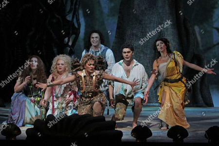 """Danielle de Niese, Layla Claire, Elizabeth DeShong, Paul Appleby, Elliot Madore, Lisette Oropesa Danielle de Niese, center foreground performs as Ariel alongside, from left, Layla Claire performing as Helena, Elizabeth DeShong performing as Hermia, Paul Appleby performing as Demetrius, Elliot Madore performing as Lysander, and Lisette Oropesa performing as Miranda during the final dress rehearsal of """"The Enchanted Island,"""" at the Metropolitan Opera in New York. """"The Enchanted Island"""" had its world premiere at the Metropolitan Opera on New Year's Eve Dec. 31, 2011"""