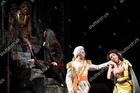 """Danielle de Niese, David Daniels, Anthony Roth Costanzo, Lisette Oropesa Danielle de Niese, left, performs as Ariel alongside David Daniels, second from left, as Prospero, Anthony Roth Costanzo, second from right, as Ferdinand, and Lisette Oropesa as Miranda during the final dress rehearsal of """"The Enchanted Island,"""" at the Metropolitan Opera in New York. """"The Enchanted Island"""" had its world premiere at the Metropolitan Opera on New Year's Eve Dec. 31, 2011"""