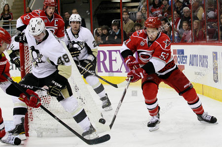 Jeff Skinner, Tyler Kennedy, Richard Park, Matt Niskanen Carolina Hurricanes' Jeff Skinner (53) tries to control the puck as Pittsburgh Penguins' Tyler Kennedy (48) defends during the second period of an NHL hockey game in Raleigh, N.C