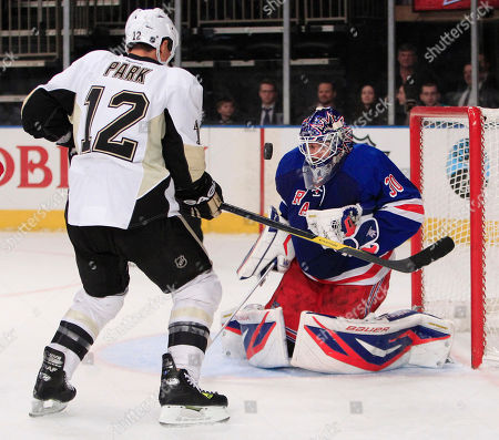 Henrik Lundqvist New York Rangers goalie Henrik Lundqvist (30), of Sweden, stops a shot on-goal by Pittsburgh Penguins' Richard Park (12), of South Korea, during the third period of an NHL hockey game, in New York. The Penguins won the game 4-1