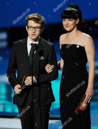 Angus T. Jones, Pauley Perrette Angus T. Jones, left, and Pauley Perrette are seen onstage during the People's Choice Awards on in Los Angeles