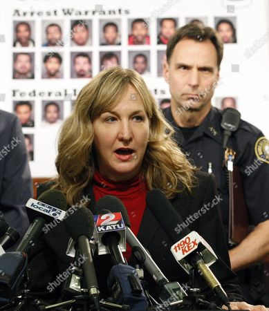 """Amanda Marshall File - In this photo, Amanda Marshall, the United States Attorney for the District of Oregon, speaks with reporters during a gang sweep news conference, as Portland Police Chief Mike Reese looks, in Portland, Ore. The U.S. Department of Justice will hold a public forum in Portland later this month as part of its investigation of the city Police Bureau and charges that it uses excessive force in encounters with mentally ill people. U.S. Attorney S. Amanda Marshall said in a statement Friday a town hall meeting is planned Feb. 28 at St. John's Community Center, and department """"invites any individual who has specific and recent information they would like to share about their personal interaction with PPB officers"""