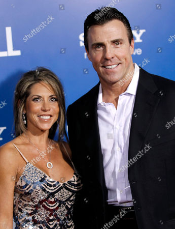 "Bill Romanowski, Julie Legrand Cast member Bill Romanowski, right, and Julie Legrand arrive at the premiere of ""Jack and Jill"", in Los Angeles. ""Jack and Jill"" opens in theaters Nov. 11, 2011"