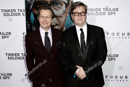 "Gary Oldman, Tomas Alfredson Cast member Gary Oldman, left, and director Tomas Alfredson pose together at the premiere of ""Tinker, Tailor, Soldier, Spy"" in Los Angeles, . ""Tinker, Tailor, Soldier, Spy"" opens in theaters Dec. 9, 2011"