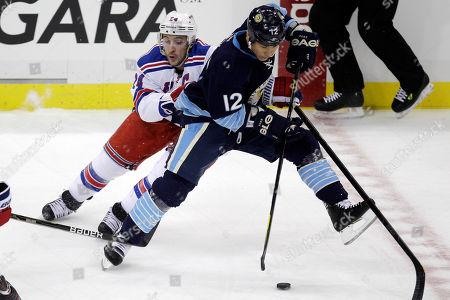 Richard Park, Ryan Callahan Pittsburgh Penguins' Richard Park (12) skates around New York Rangers' Ryan Callahan (24) in the first period of an NHL hockey game in Pittsburgh