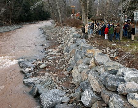 A group representing environmental organizations is told about improvements to the bank and flow of the Stony Clove Creek in Phoenicia, N.Y. The work was planned before Hurricane Irene and Tropical Storm Lee, but done after the area was flooded