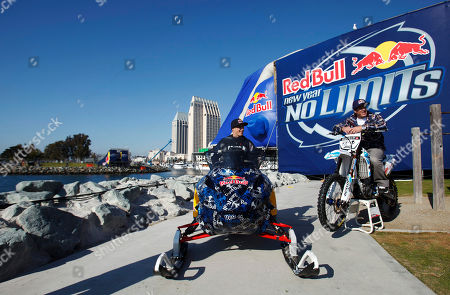 "Levi LaVallee, Robbie Maddison Snowmobiler Levi LaVallee, left, and motorcyclist Robbie Maddison pose for photographers below the landing ramp for an upcoming simultaneous jump, in San Diego. The riders plan to jump across a harbor entrance on the San Diego Bay before midnight on New Year's Eve as part of the ""Red Bull: New Year. No Limits"" event"