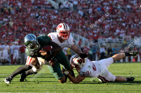 Darron Thomas, Brendan Kelly, Mike Taylor Oregon quarterback Darron Thomas, left, is stopped by Wisconsin's Brendan Kelly, center and Mike Taylor, right, during the first half of the Rose Bowl NCAA college football game, in Pasadena, Calif
