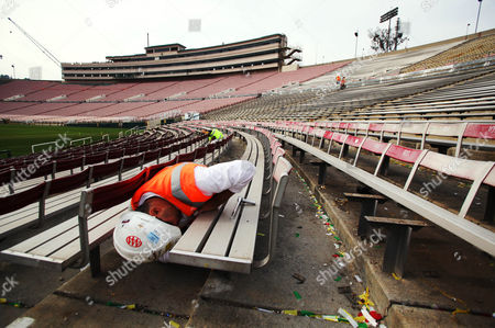 Construction worker John Baron unbolts seats in preparation for tunnel widening and new aisles as phase two of the renovation of the Rose Bowl stadium continues with the demolition of the press box and other construction . When completed, the press box will increase from about 45,000 square feet to 150,000 square feet. Other projects in phase two include widening of tunnels, adding new aisles, concrete and wall repair on the north side of the stadium. The three-year project is expected to be completed in time for the 100th Rose Bowl football game in 2014