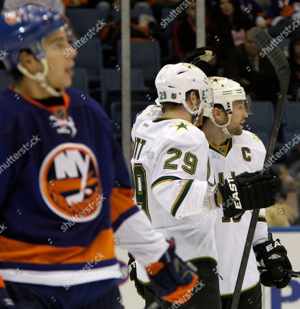Steve Ott, Brenden Morrow, Travis Hamonic Dallas Stars center Steve Ott (29) celebrates with Stars left wing Brenden Morrow (10) after Morrow scored in the third period of the Stars' 3-2 victory over the New York Islanders in their NHL hockey game at Nassau Coliseum in Uniondale, N.Y., . Islanders defenseman Travis Hamonic, left, looks on