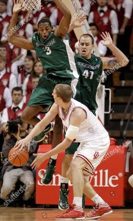 Stock Image of Cody Zeller, Willie Green, Adam Pegg Indiana's Cody Zeller makes a pass while being defended by Stetson's Willie Green, left, and Adam Pegg during the first half of an NCAA college basketball game, in Bloomington, Ind