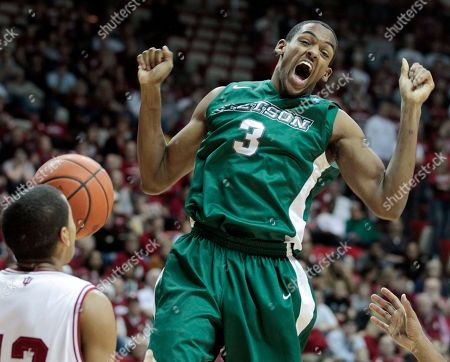 Stock Photo of Verdell Jones III, Willie Green Stetson's Willie Green reacts following a dunk, in front of Indiana's Verdell Jones III during the first half of an NCAA college basketball game, in Bloomington, Ind