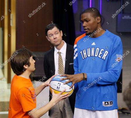 Kevin Durant, Taylor Gray, Timothy Fall Oklahoma City Thunder forward Kevin Durant, right, rehearses a scene with actor Taylor Gray, left as actor Timothy Fall, center, looks, during shooting for the movie Thunderstruck in Oklahoma City, . Durant stars as himself in the movie