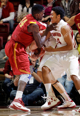 Josh Huestis, Dewayne Dedmon Southern California forward Dewayne Dedmon (14) and Stanford forward Josh Huestis (24) fight for ball in the first half of an NCAA college basketball game in Stanford, Calif