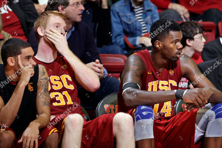 Dewayne Dedmon, James Blasczyk Southern California forward Dewayne Dedmon (14) and center James Blasczyk (31) watch the game against Stanford in the second half of an NCAA college basketball game in Stanford, Calif., . Stanford won 51-43