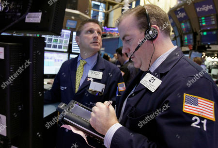 James Doherty Trader James Doherty, right, works on the floor of the New York Stock Exchange, . U.S. stocks fell broadly Monday on lingering fears about European countries' indebtedness, despite their fiscal pact last week