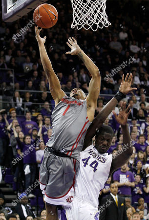 Reggie Moore, Darnell Gant Washington's Darnell Gant (44) fouls Washington State's Reggie Moore in the first half of an NCAA college basketball game, in Seattle