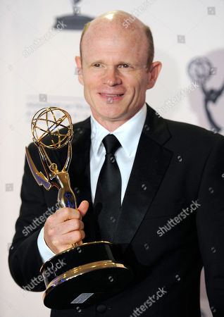 "Paul McCrane Paul McCrane pose backstage with his award for outstanding guest actor in a drama series for ""Harry's Law"" at the Primetime Creative Arts Emmy Awards on in Los Angeles"