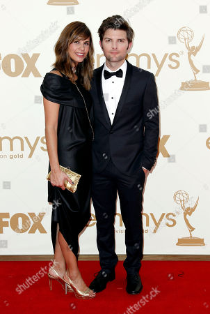 Adam Scott, Naomi Sablan Adam Scott, right, and Naomi Sablan arrive at the 63rd Primetime Emmy Awards on in Los Angeles