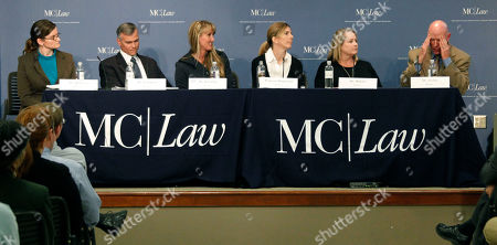 Michael Tucker, scientific director with Georgia Reproductive Specialists, right, reacts during a discussion of the implications of Mississippi's Personhood Initiative in a symposium Tuesday night, at the Mississippi College School of Law in Jackson, Miss. The practicing attorneys, law professors and others debated the implications of the state ballot initiative that would declare life begins when a human egg is fertilized
