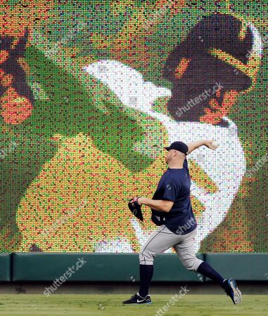 Detroit Tigers starting pitcher Brad Penny throws in the outfield before Game 1 of baseball's American League championship series against the Texas Rangers, in Arlington, Texas