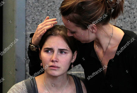 """Amanda Knox Amanda Knox, left, is comforted by her sister, Deanna Knox, during a news conference shortly after her arrival at Seattle-Tacoma International Airport, in Seattle. Italy's high court took up the appeal of Amanda Knox's murder conviction, considering the fate of the """"very worried"""" American and her Italian former boyfriend in the brutal 2007 murder of Knox's British roommate. A decision had been expected as early as Wednesday, but with a full caseload Wednesday and other court matters Thursday, the presiding judge said a ruling may not come down until Friday"""