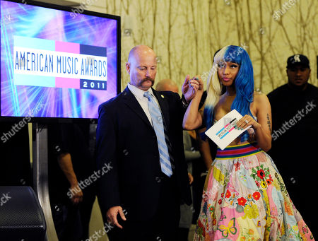 Nicky Minaj Nicky Minaj is helped to the stage to announce nominations for the 2011 American Music Awards, in Los Angeles. The awards will be held in Los Angeles on November 20