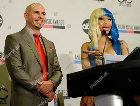 Nicky Minaj, Pitbull Pitbull, left, reacts as Nicky Minaj announces him as a nominee for Favorite Male Artist during nominations for the 2011 American Music Awards, in Los Angeles. The awards will be held in Los Angeles on November 20