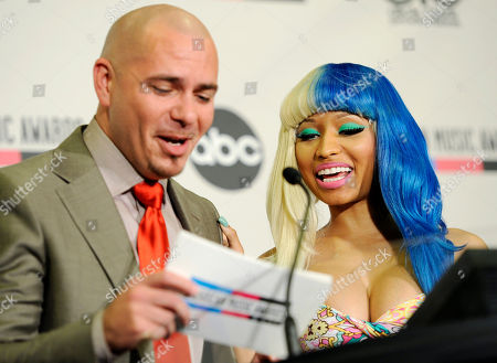 Nicky Minaj, Pitbull Pitbull, left, and Nicky Minaj share a laugh as they announce nominations for the 2011 American Music Awards, in Los Angeles. The awards will be held in Los Angeles on November 20