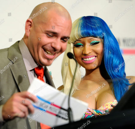 Nicky Minaj, Pitbull Rap artist Pitbull, left, and singer Nicky Minaj share a laugh as they announce nominations for the 2011 American Music Awards, in Los Angeles. The awards will be held in Los Angeles on November 20