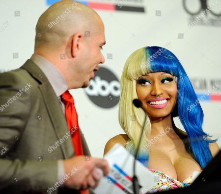 Nicky Minaj, Pitbull Nicky Minaj, right, reacts as Pitbull announces her as a nominee in the Rap Hip Hop category during nominations for the 2011 American Music Awards, in Los Angeles. The awards will be held in Los Angeles on November 20